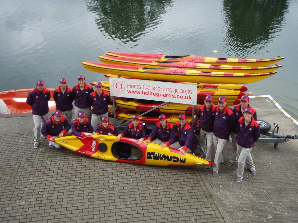 HCL Team with boats in front of lake
